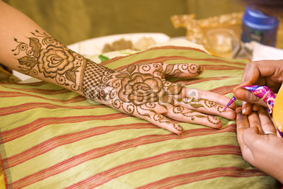 Applying Mehndi Design on Hands